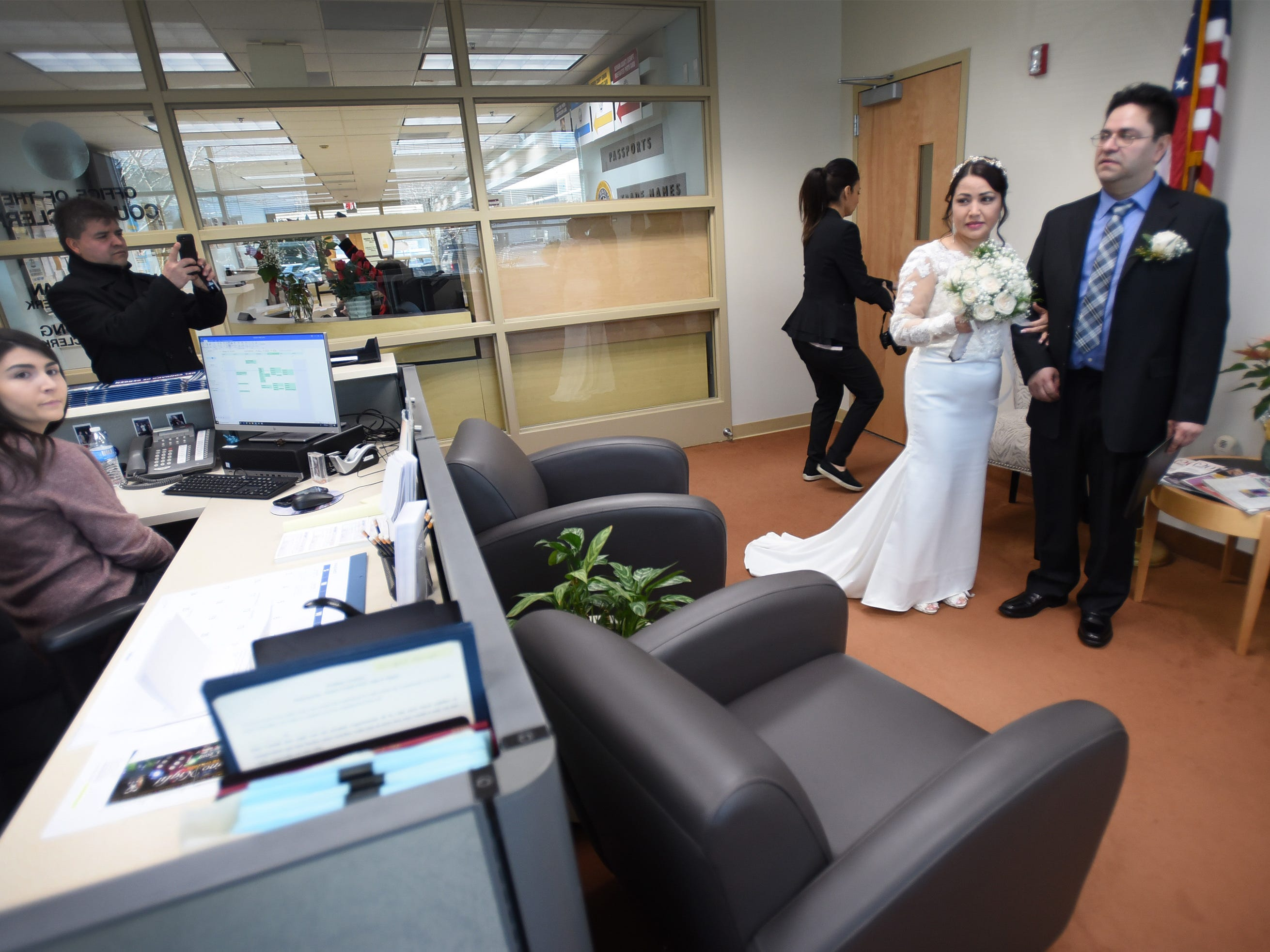 Gloria Gallego and Alexander Gutierrez of Englewood, arrive at Bergen County Clerk's Office for their wedding ceremony, located at Bergen County Plaza in Hackensack on 02/14/19.
