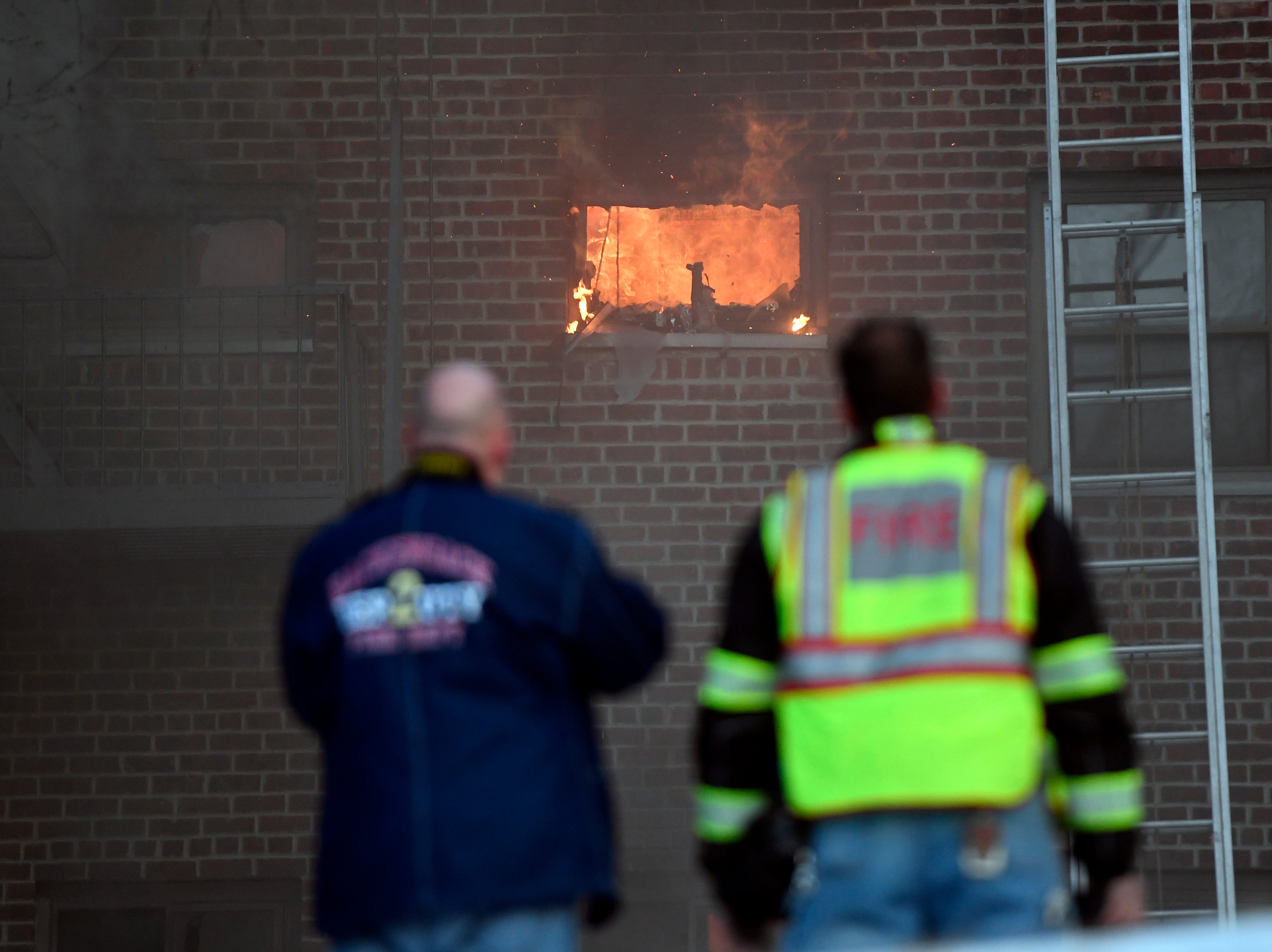 Emergency personnel look on as a fire rages within an apartment building on Edwin avenue in Fort Lee on Thursday, Feb. 14, 2019.