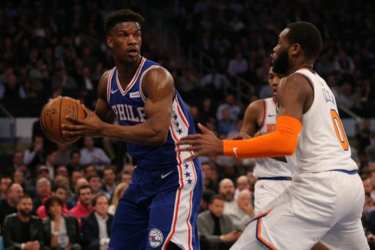 Philadelphia 76ers guard Jimmy Butler (23) controls the ball as New York Knicks guard Kadeem Allen (0) defends during the first quarter at Madison Square Garden.