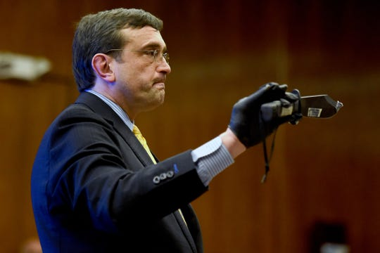 Closing arguments are delivered in the trial of Arthur Lomando at the Bergen County Courthouse in Hackensack on Thursday, February 14, 2019. Lomando, a former New York City police officer, is accused of murdering Suzanne Bardzell, his ex-girlfriend, with a machete. Attorney Anthony LaPinta, shows the machete used to kill Bardzell to the jury during  closing arguments for his client Lomando, not pictured.