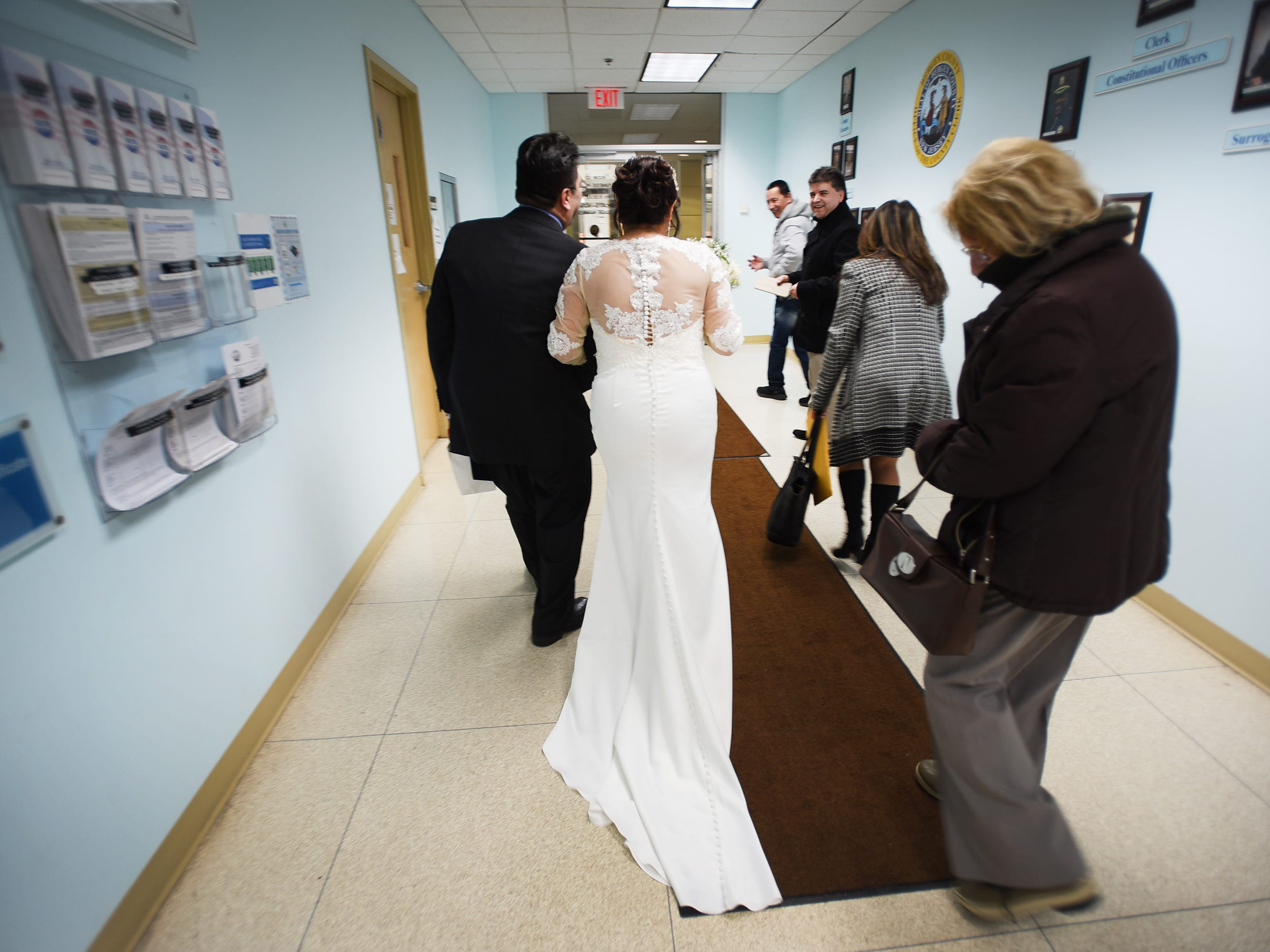 Gloria Gallego and Alexander Gutierrez of Englewood, hold hands as they leave from Bergen County Plaza following their wedding ceremony in Hackensack on 02/14/19.