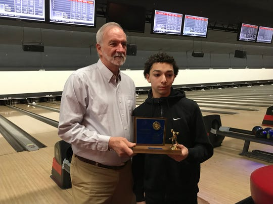 NJSIAA official Al Stumpf presents Clifton's Jeremy Ramirez with the high game trophy after the freshman rolled a 278 at the state boys bowling team finals on Thursday, Feb. 14, 2019 at Bowlero North Brunswick.