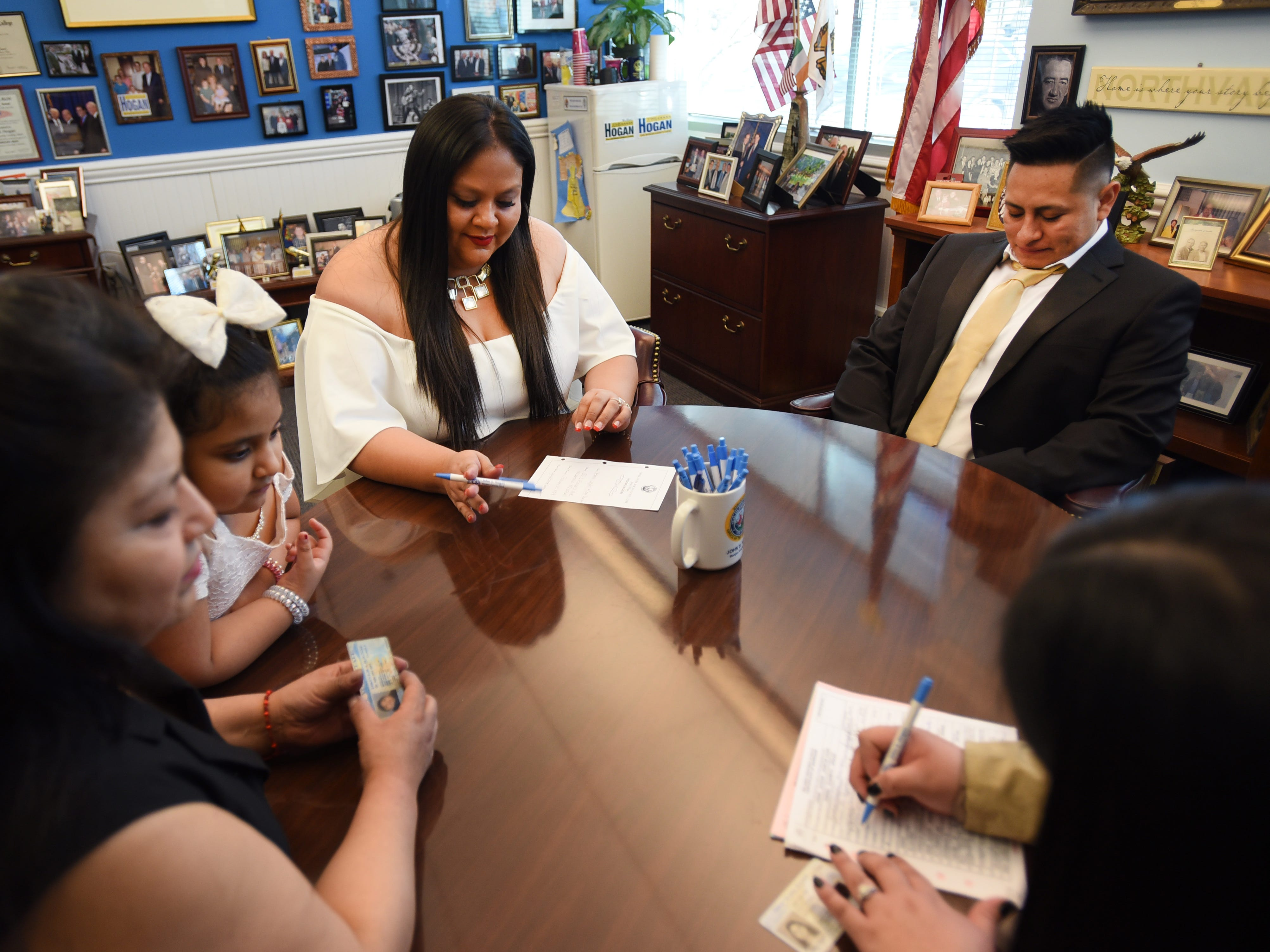 Bride and groom, Yesenia Urgiles and Cesar Guartan of Hackensack, sign for their marriage certificate prior to their wedding ceremony at Bergen County Clerk's Office, located at  Bergen County Plaza in Hackensack on 02/14/19.