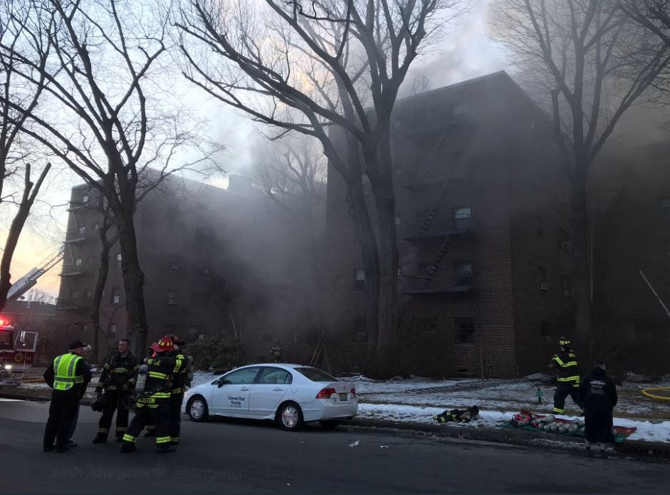 Firefighters battle a blaze at a Fort Lee apartment building on Thursday.