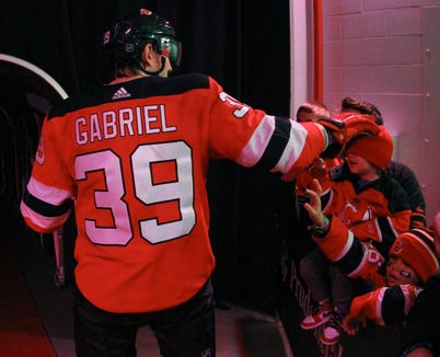 Feb 10, 2019; Newark, NJ, USA; New Jersey Devils right wing Kurtis Gabriel (39) pats a young fan on the head before the start of the third period at Prudential Center.