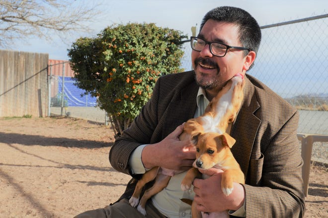 Matt Robinson, president of the Deming-Luna County Humane Society takes in the sun with man's best friend.