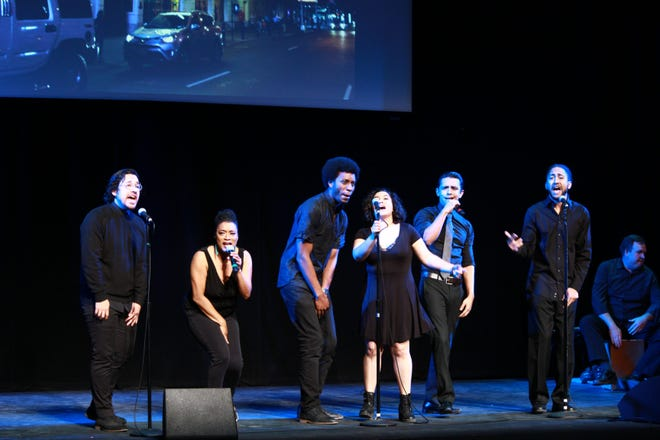 """Singers present a song from """"Hamilton"""" during one of Megan McQueen's presentations."""