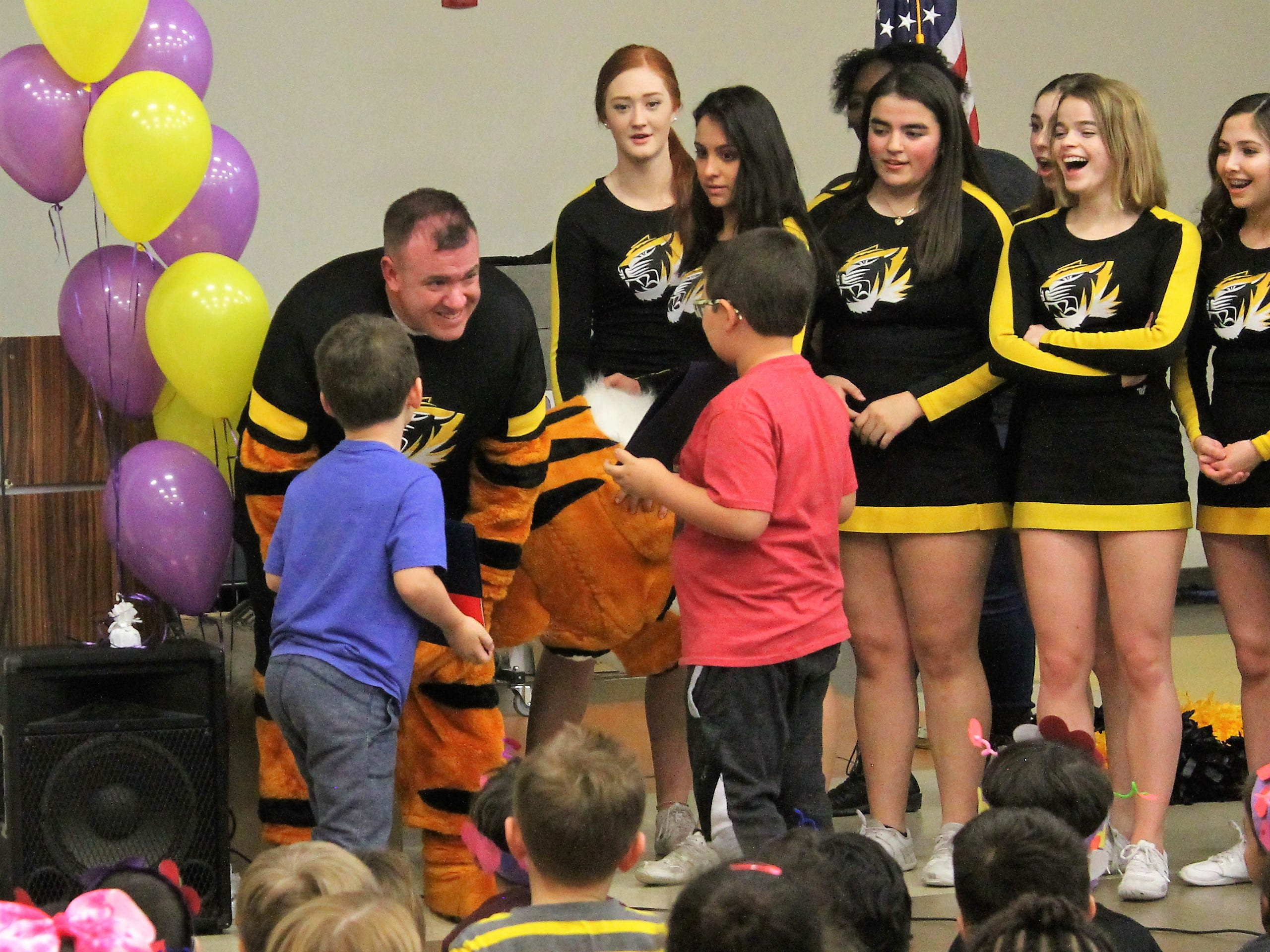 Ethan Scott who was dressed as the Alamogordo High School Tiger mascot revealed himself to his sons Dominic and Corben Scott at a Desert Star Elementary School assembly Feb. 14. Ethan had just returned from a six-month tour of Kuwait.