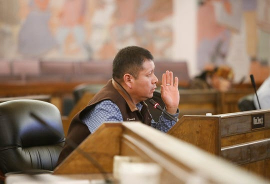 Navajo Nation Council Delegate Wilson Stewart Jr. comments about a report by the Navajo Transitional Energy Company's work to possibly acquire the Navajo Generating Station and the Kayenta Mine during a Naa'bik'íyáti' Committee work session on Wednesday in Window Rock, Ariz.