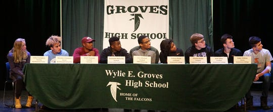 Students at Birmingham Groves 2019 Signing Day ceremony on Feb. 13. From left: Celia Crompton, Amedeo Crovasce, Khalil Dawsey, Damonte McCurdy, Joel Mitchell, Lindsey Nedd, Charlie Riddle, Josh Salter, and Gabe Vidinas.
