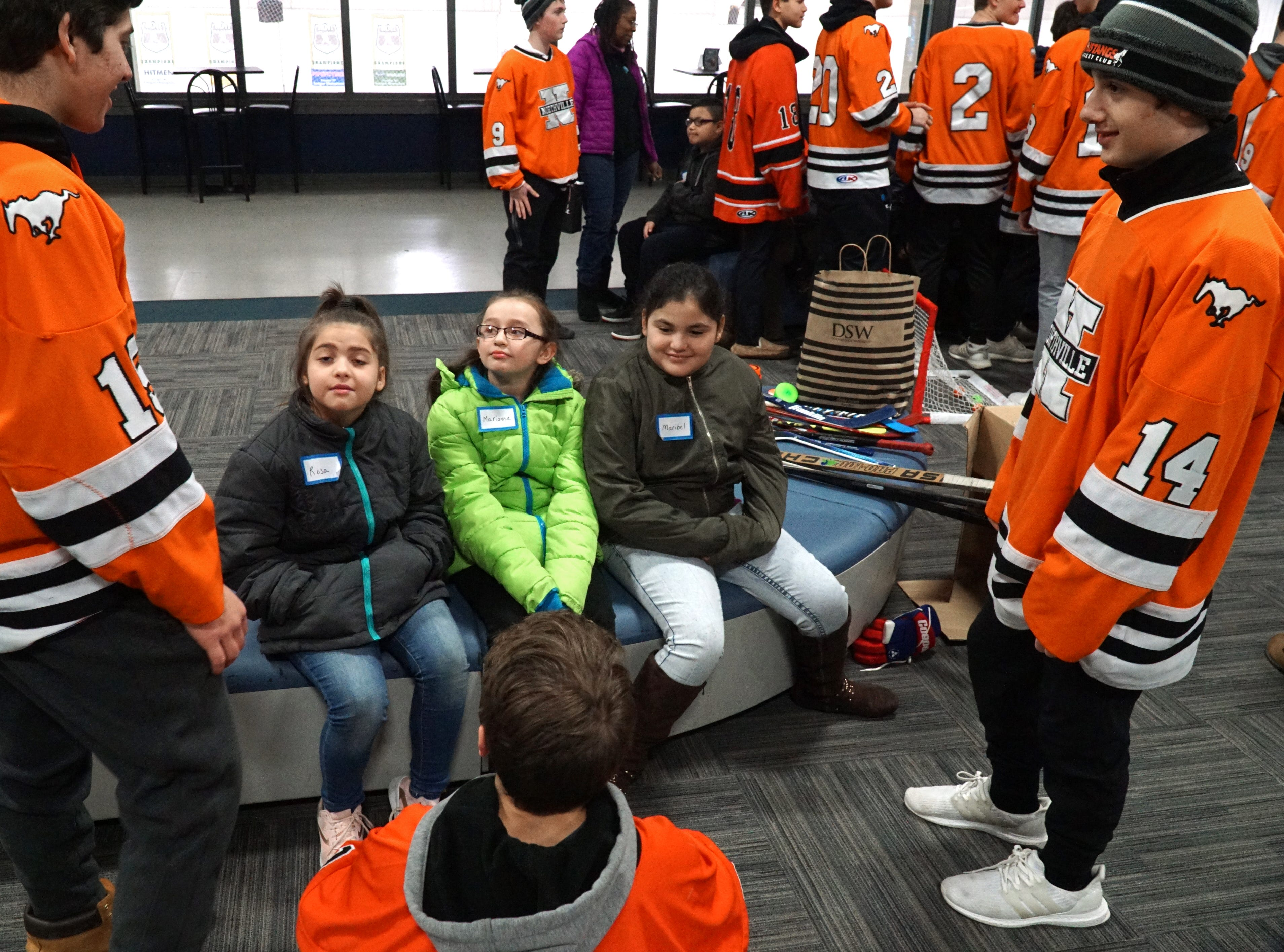 Members of Northville High School's hockey greet their visitors from Neinas Elementary in Detroit at the Novi Ice Arena on Feb. 13.