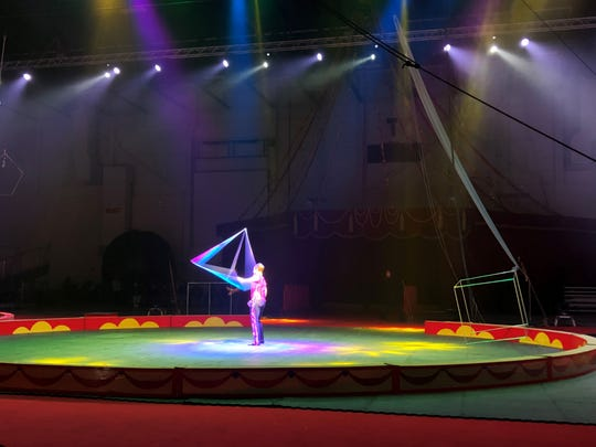 A Shrine Circus performer celebrates the expansion of the Suburban Collection Showplace in Novi on Feb. 13, 2019.