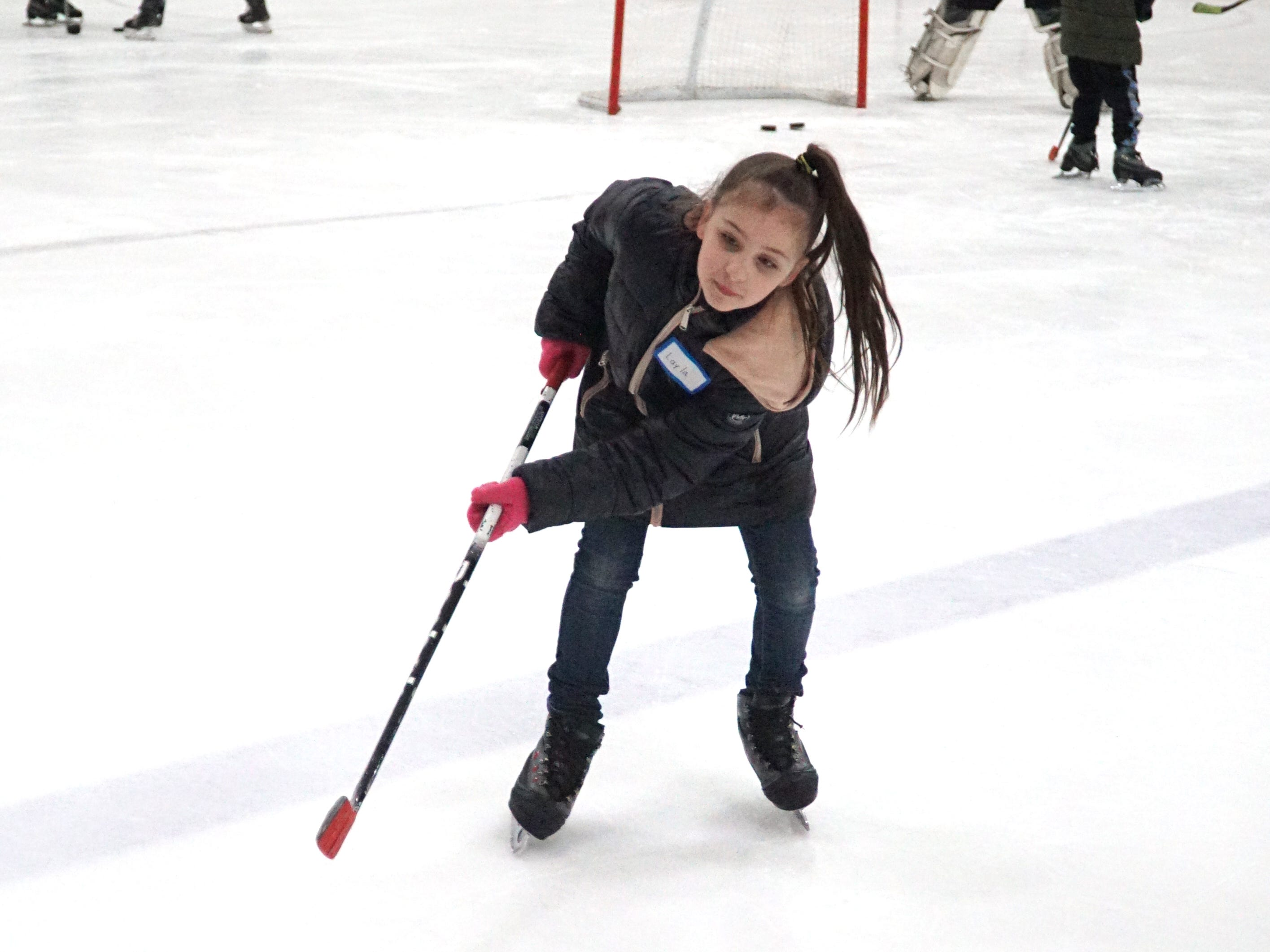 Layla Abbott, 9, takes a slap shot at the net during her time on the ice at the Novi Ice Arena. The Neinas Elementary student was being assisted in her hockey skills by Northville varsity players.
