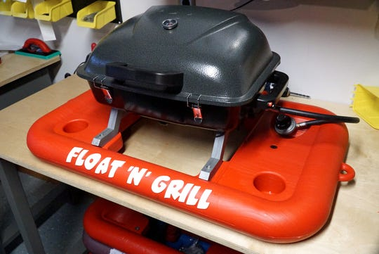Mike Bashawaty's Float 'N Grill unit. The plastic floating support system is able to keep a fully-lit gas grill going in the water as the grill's heat is dissipated by the aluminum brackets that connect the float and grill.