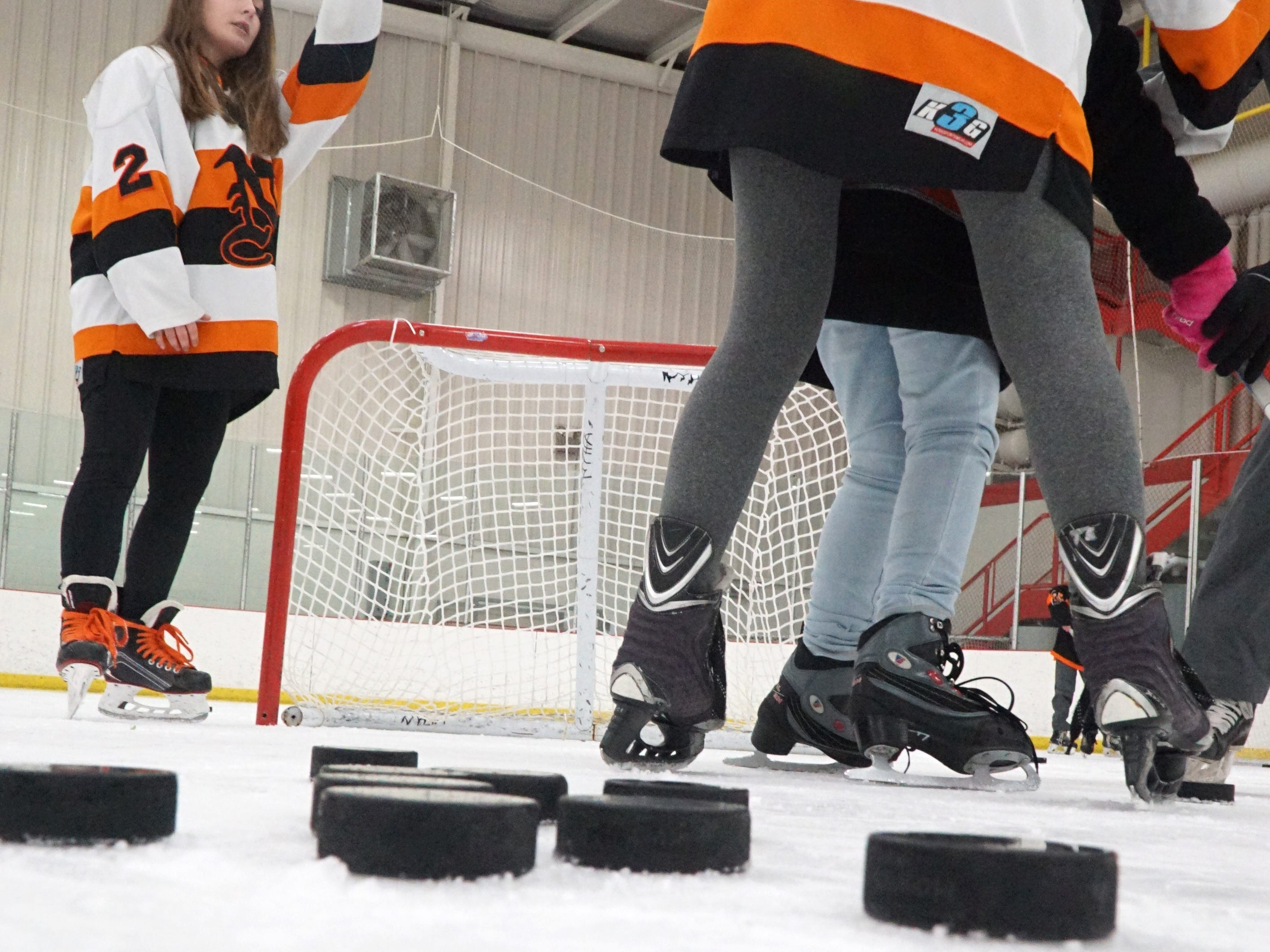 There were lots of hockey sticks and pucks on the ice on Wednesday at the ice arena.
