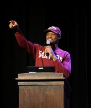 Birmingham Groves' Khalil Dawsey, who will be attending Harvard University on a football scholarship, aknowledges some supporters during the school's Feb. 13 Signing Day ceremony.