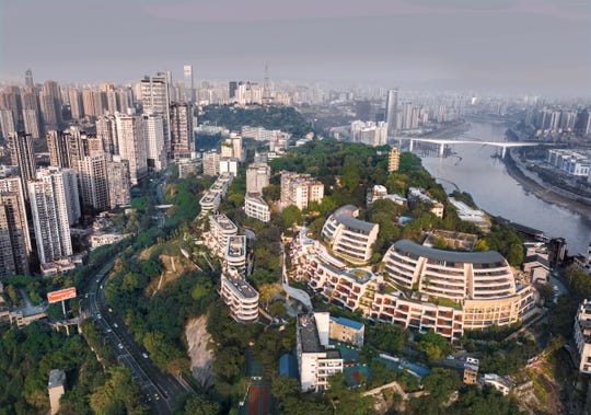 The Eling Residences in Chongqing, China, seen in the lower right, were recently completed by Safdie Architects.