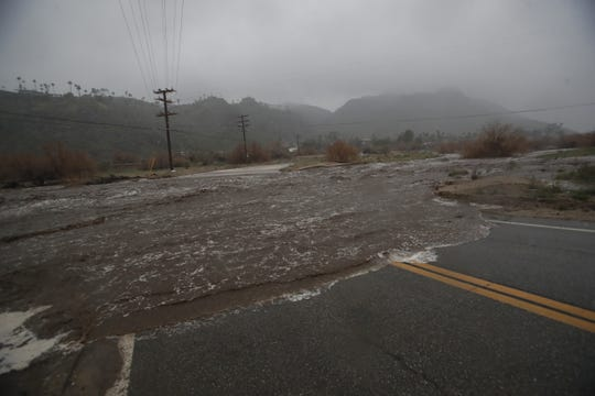 Heavy rains entered the Coachella Valley on February 14, 2019. In this photo Araby Trail in the south of Palm Springs as water rushed down the Tahquitz wash.