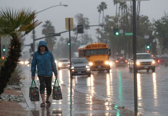 Large amounts of rain filled streets and the Coachella Valley stormwater channel in Palm Springs.