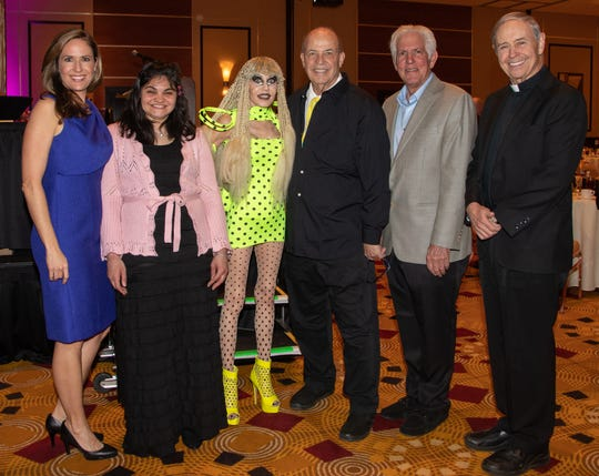 (left to right) Brooke Beare, Event Emcee and Board Chair of Desert Arc, Desert Arc Client of the Year Veronica, Honorees Karen & Tony Barone, Richard Balocco, President/CEO of Desert Arc, and Honoree Reverend Monsignor Howard A. Lincoln