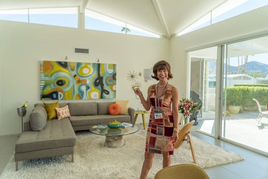 A woman wears retro attire at a Modernism Week home tour