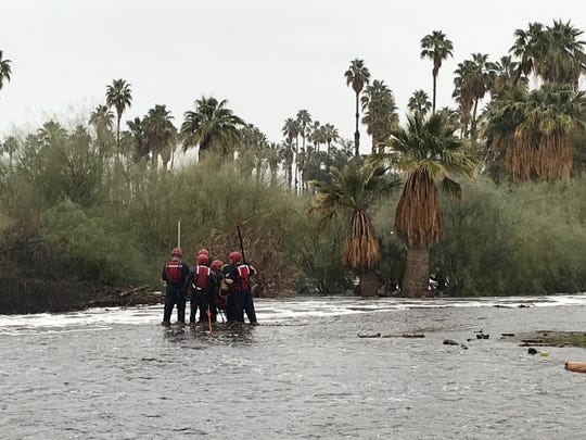 Crews attempt a swift-water rescue in Palm Springs after heavy rainfall and flooding, Feb. 14, 2019