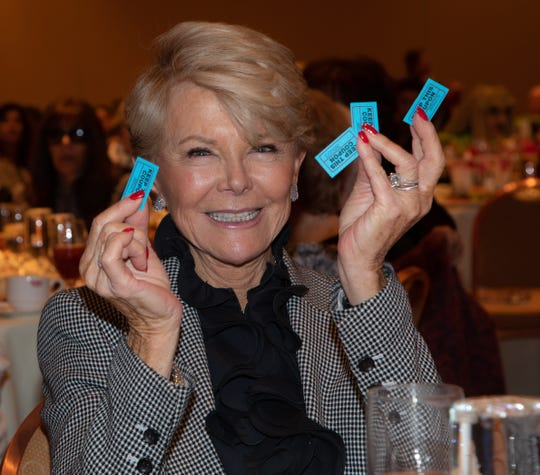 Event Presenting Sponsor Nancy Stone with her batch of winning raffle tickets!