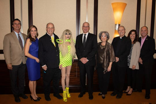 (left to right) Honoree George Sanchez of Design Construction, Brooke Beare, Board Chair of Desert Arc, Honorees Tony Barone & Karen Barone, Kurt Schoppe of SA Organics Recycling, Event Chair & Desert Arc Board Member Nancy Singer, Reverend Monsignor Howard A. Lincoln, Honoree Patti Stutz of Stutz Packing Company, and Honoree Glenn Miller, Desert Arc Board Member & Mayor Pro Tem of City of Indio