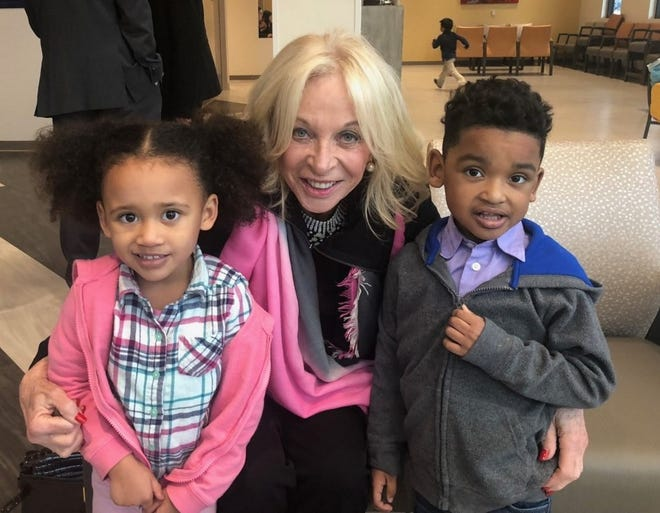 Big hearted Maddy Redstone (center) with twins Callia and Matthew Castlebury.
