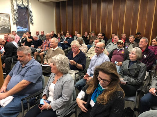 Gulf Breeze residents pack the City Council chambers on Wednesday evening when the council announced its appointee to fill the vacant council seat.