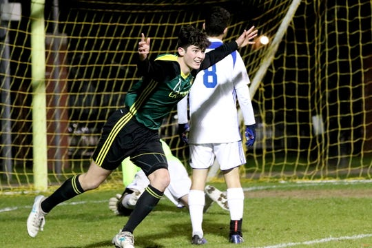 Catholic's John Carlson celebrates his opening goal against Bolles on Feb. 13, 2019. The Crusaders won 2-1 to advance to the FHSAA state semifinal.