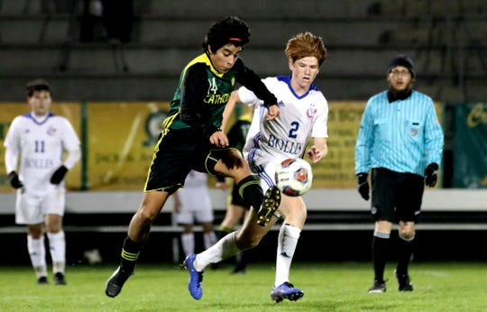 Catholic's Mario Cardenas dribbles the ball against Bolles on Feb. 13, 2019. The Crusaders won 2-1 to advance to the FHSAA state semifinal.