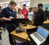 Wireless device geolocation and password security are two topics of expertise for these University of West Florida cybersecurity ambassadors.