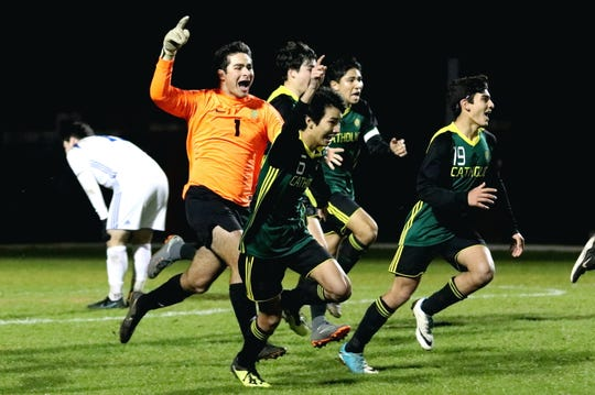 Catholic goalie Mack Hamrick (1) sprints to the student section with teammates after Catholic defeated Bolles 2-1 on Feb. 13, 2019 to qualify for the FHSAA state semifinals.