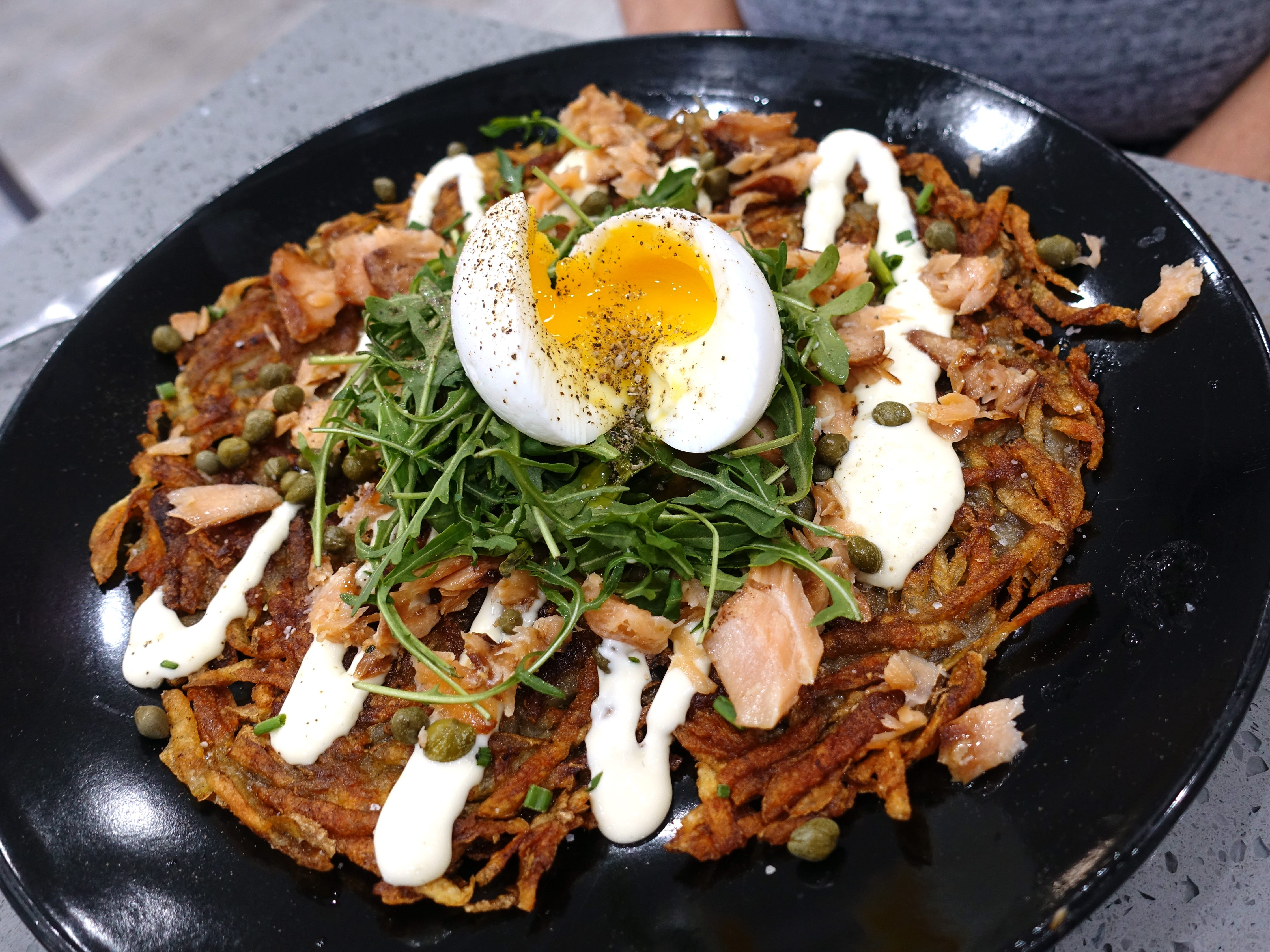 The French Connection: potato tartin with mesquite-smoked salmon, soft-boiled egg, capers, Brie sauce, chives and arugula at Sweetest Season Artisan Eatery in Tempe.