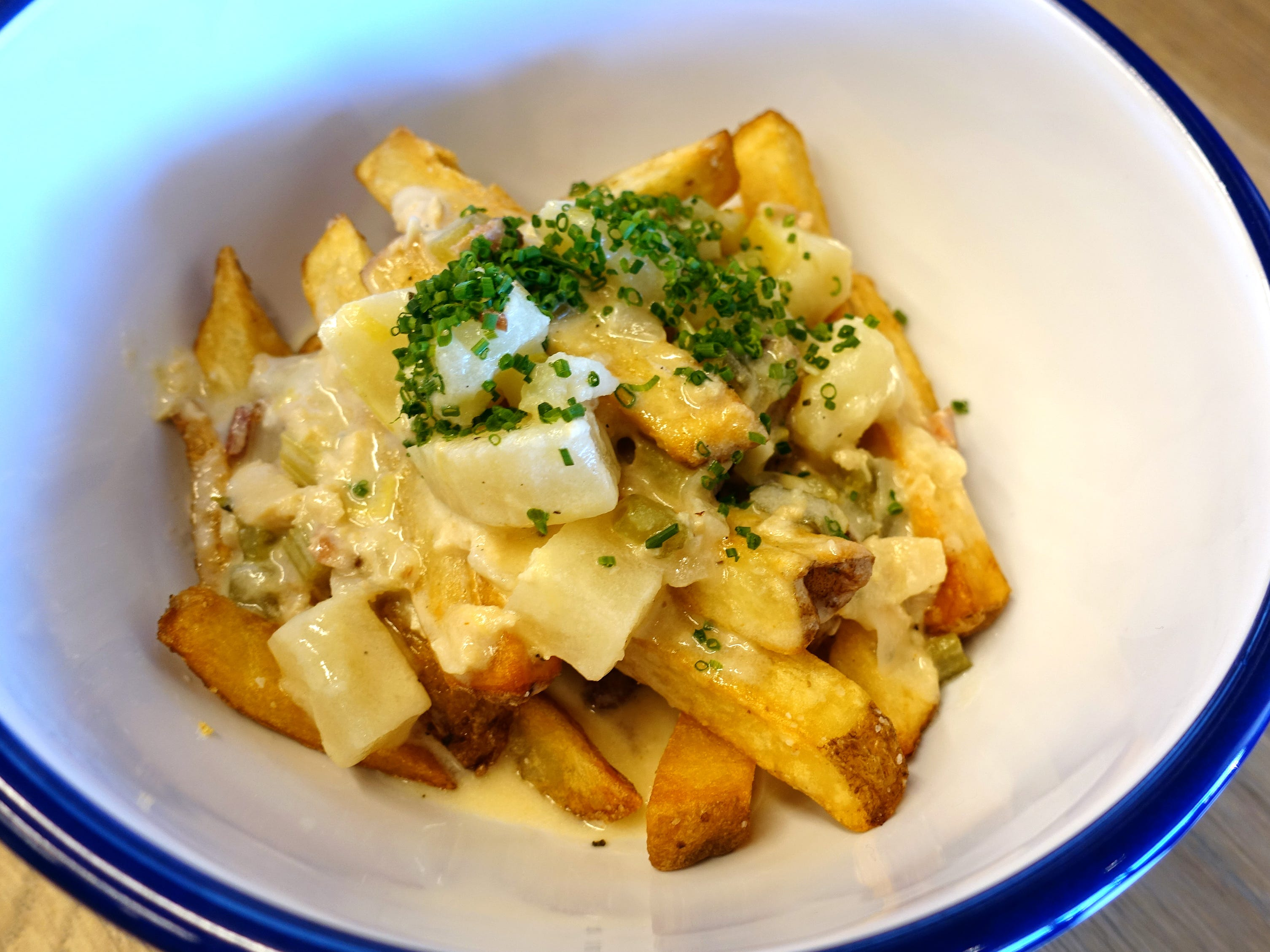 Chowder fries: Frites Street fries and chowder with Niman's bacon, chopped clams, potatoes and sherried cream at Chula Seafood Uptown in Phoenix.