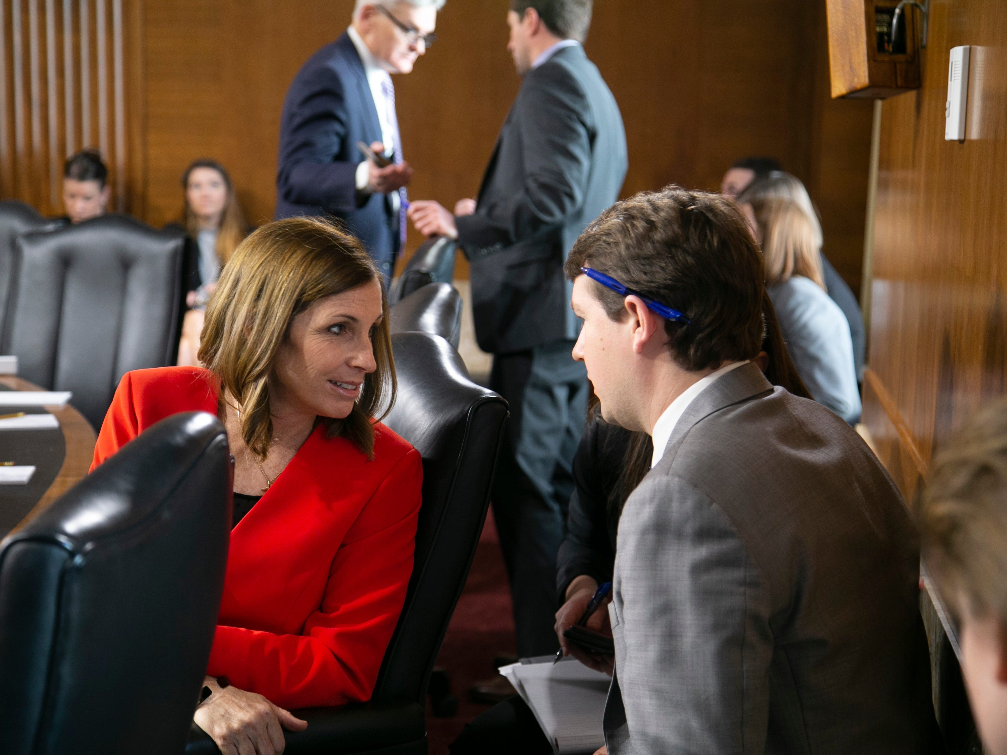 U.S. Sen. Martha McSally speaks to an aide during the U.S. Senate Committee on Energy and Natural Resources hearing at the U.S. Capitol in Washington D.C. on Feb. 5, 2019.