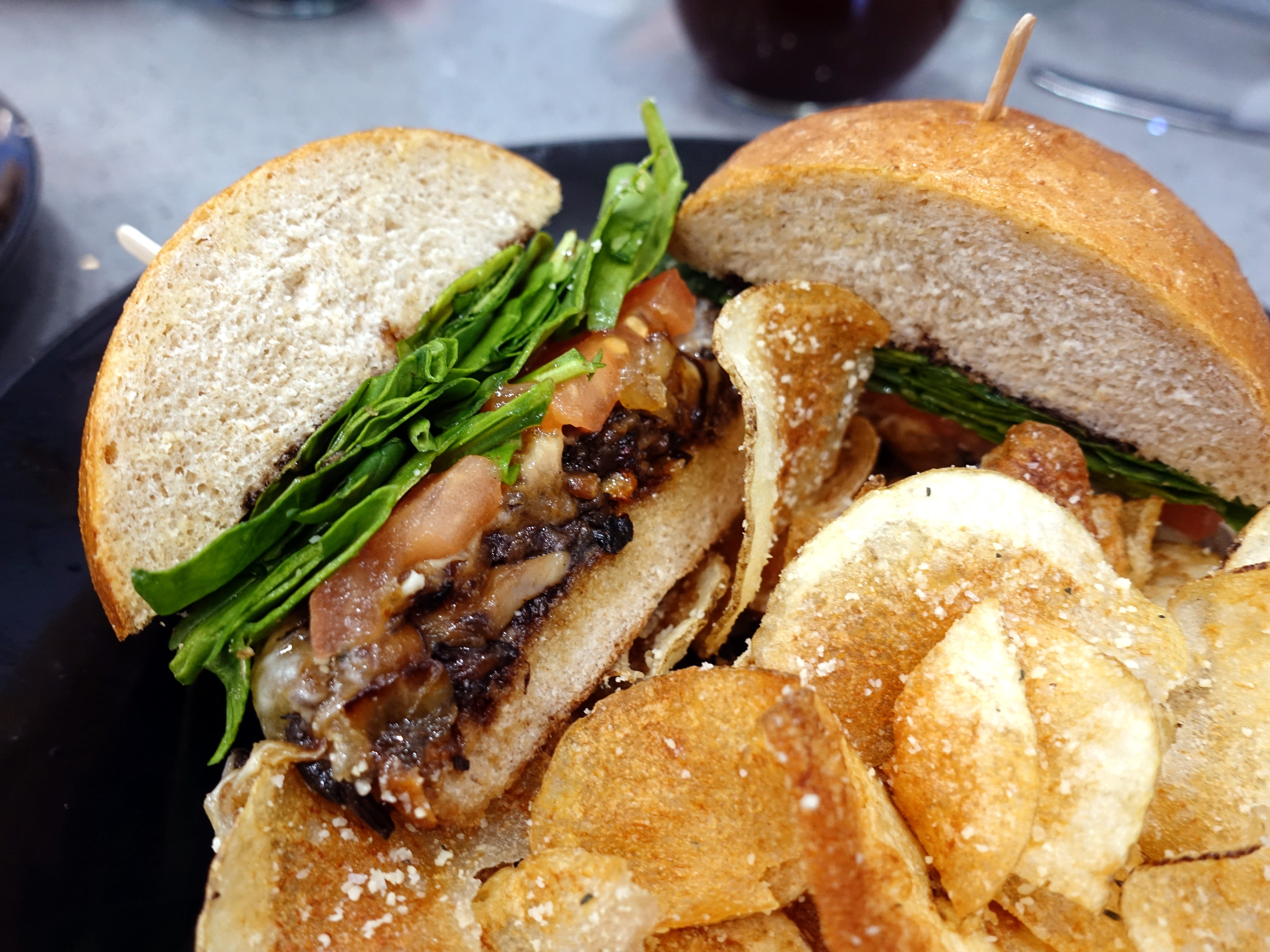 'We Forgot the Meat!' with sauteed mushrooms, caramelized onions, provolone, balsamic glaze, fresh spinach, tomato and roasted garlic olive oil at Sweetest Season Artisan Eatery in Tempe.