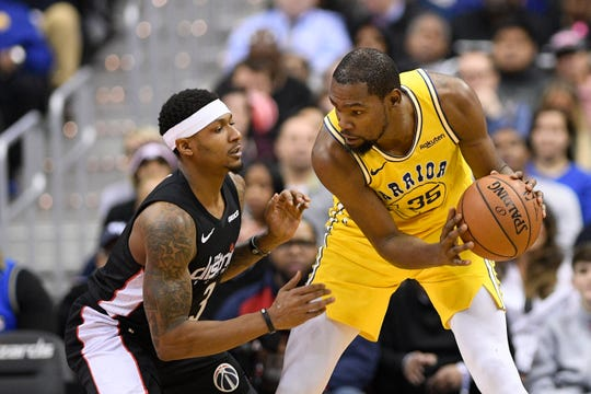 Golden State Warriors forward Kevin Durant (35) holds the ball against Washington Wizards guard Bradley Beal, left, during the second half of an NBA basketball game, Thursday, Jan. 24, 2019, in Washington. The Warriors won 126-118. (AP Photo/Nick Wass)
