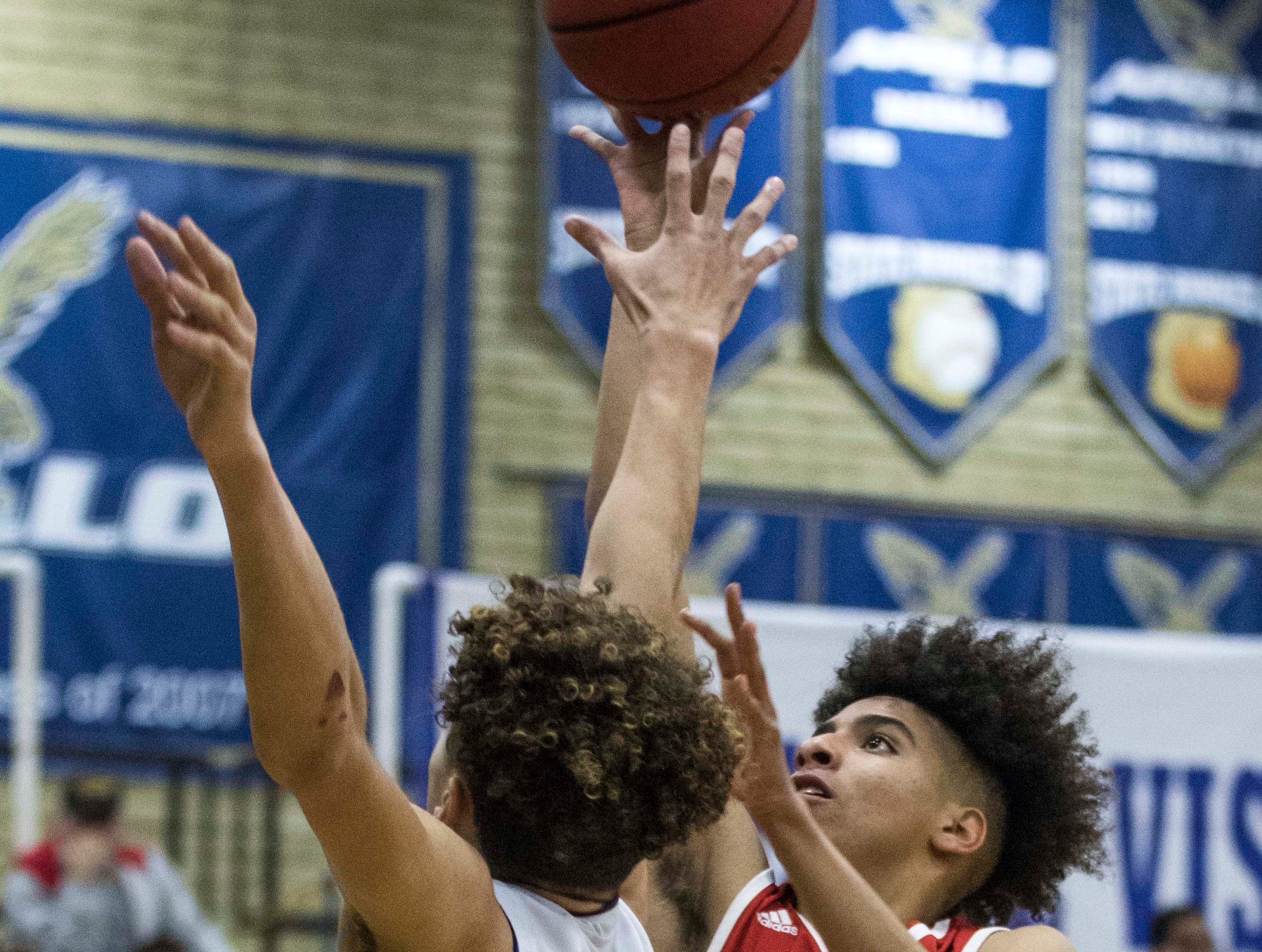 South Mountain's Fontane RossÊ(2) puts up a shot against Apollo's Jaylen Glover (4) during the first half of their game in Phoenix, Wednesday, Feb .13,  2019.
