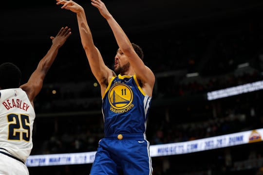 Golden State Warriors guard Klay Thompson (11) in the first half of an NBA basketball game Tuesday, Jan. 15, 2019, in Denver. (AP Photo/David Zalubowski)