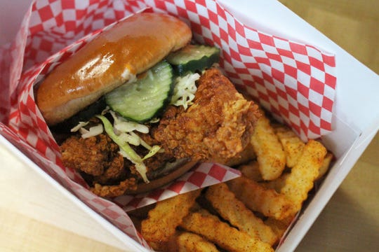 Monroe's Hot Chicken in downtown Phoenix serves Nashville-style hot chicken in sandwiches and as tenders with a side of fries.