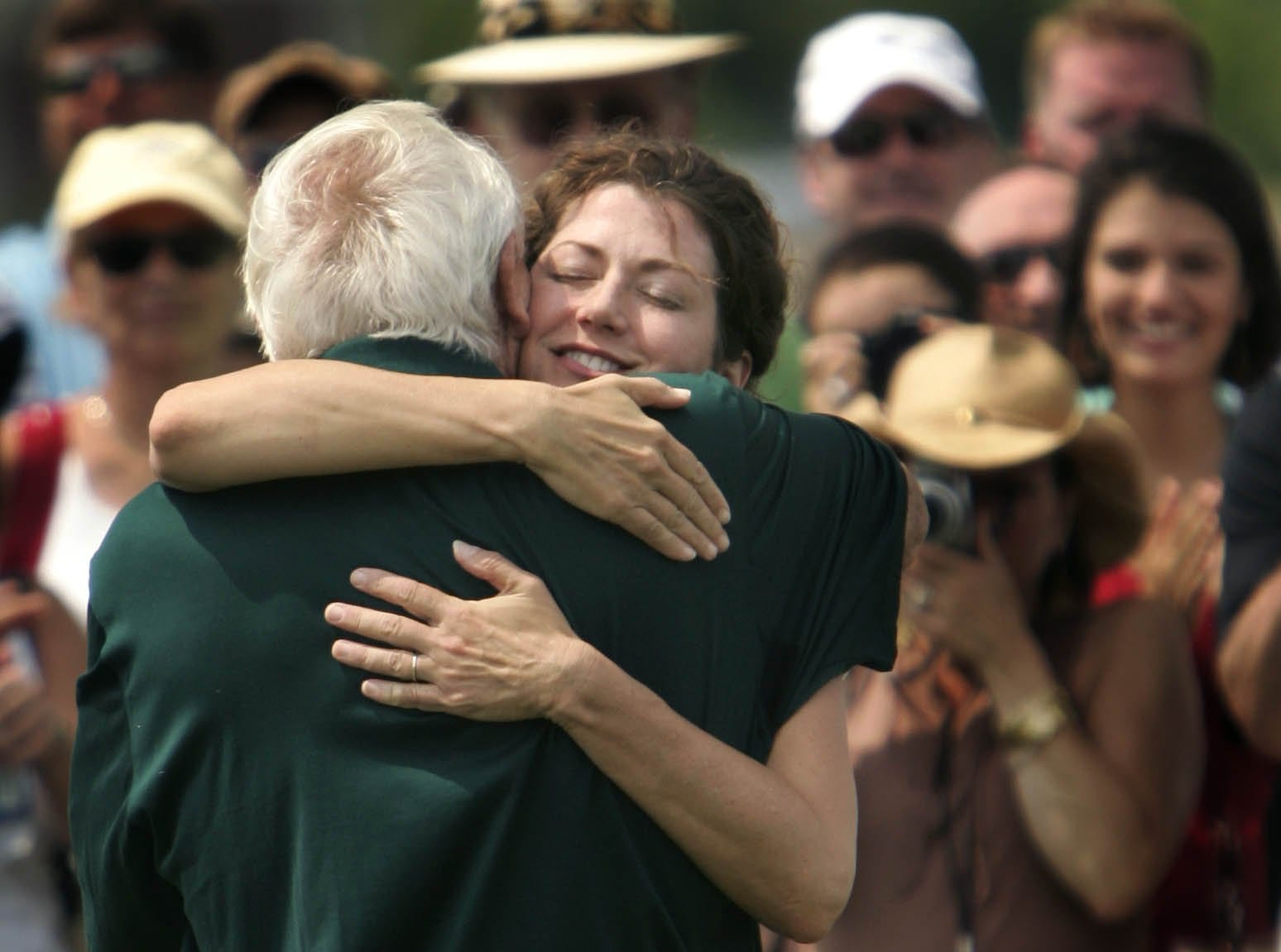 Amy Grant hugs Arnold Palmer during a golf clinic conducted by Palmer on June 26, 2006, in Nashville, Tennessee.