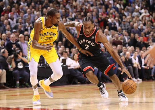 Toronto Raptors forward Kawhi Leonard and Golden State Warriors forward Kevin Durant (35) are two of the best potential free agents in the NBA.