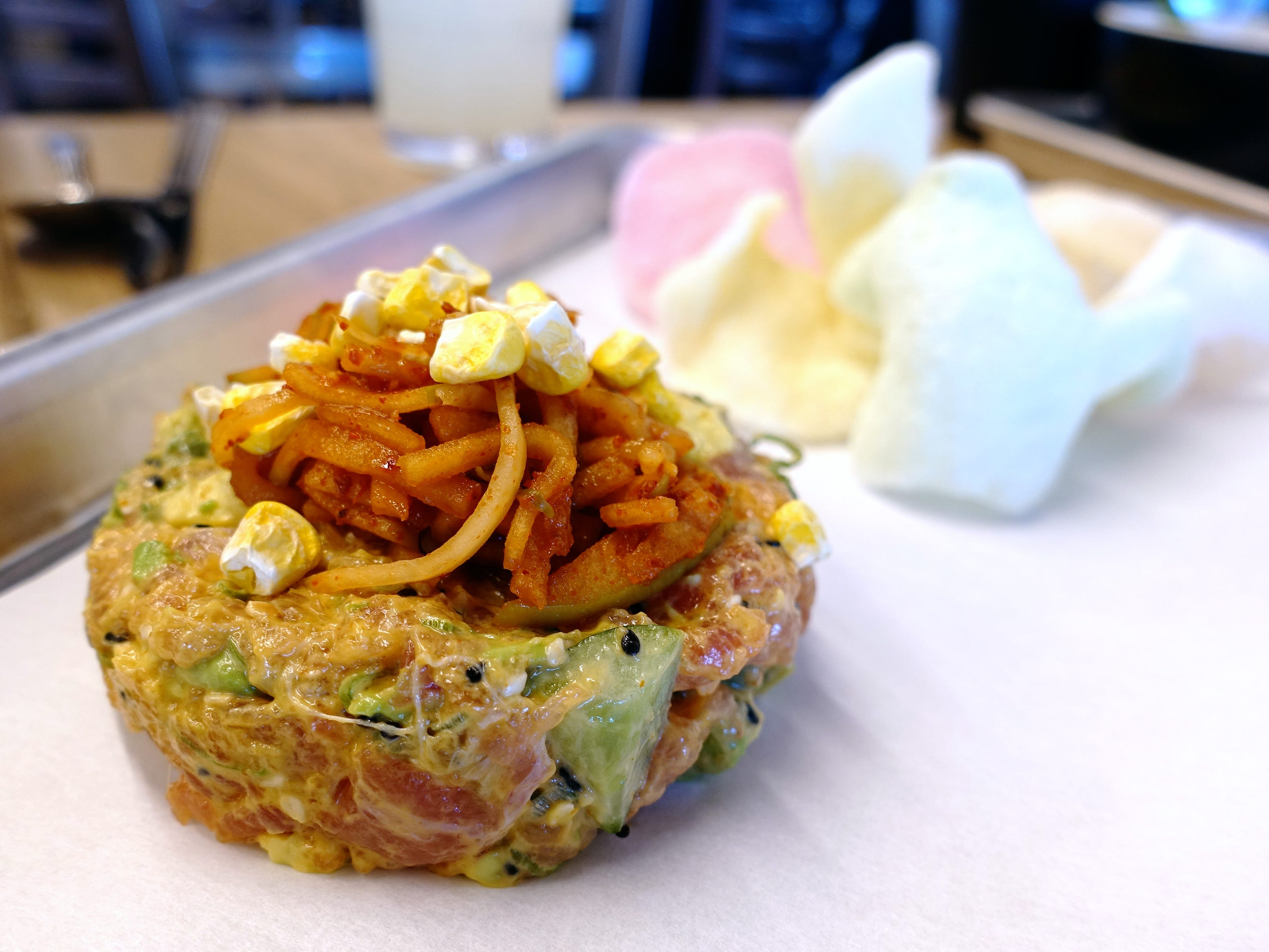 Tuna tartare with spicy Kewpie mayo, cucumber, jalapeno, scallion, corn, green apple kimchi and shrimp chips at Chula Seafood Uptown in Phoenix.