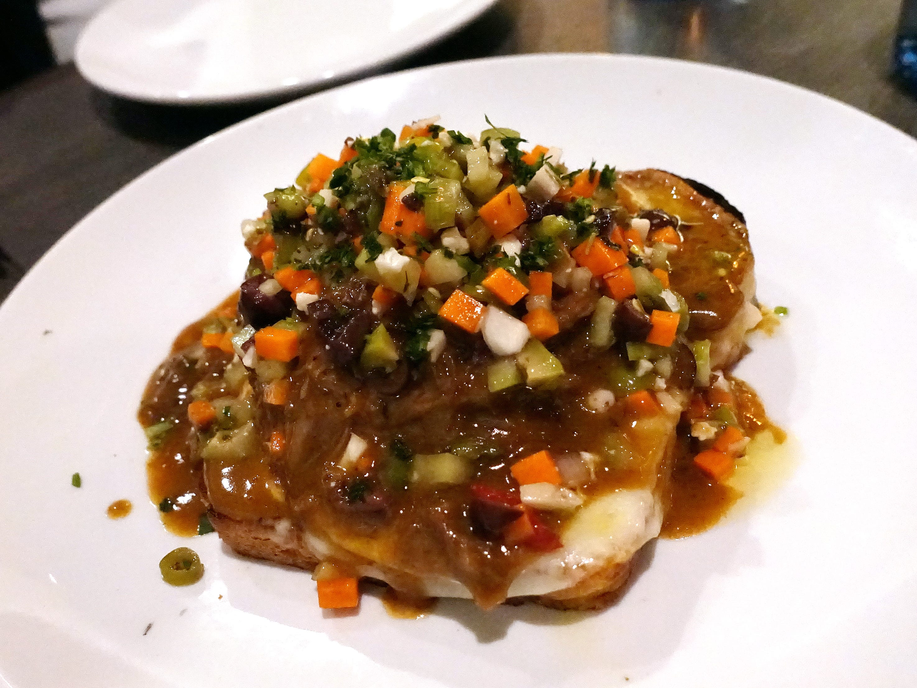 Italian beef with braised oxtail, smoked provolone, Chicago-style giardiniera and brioche at Hush Public House in Scottsdale.