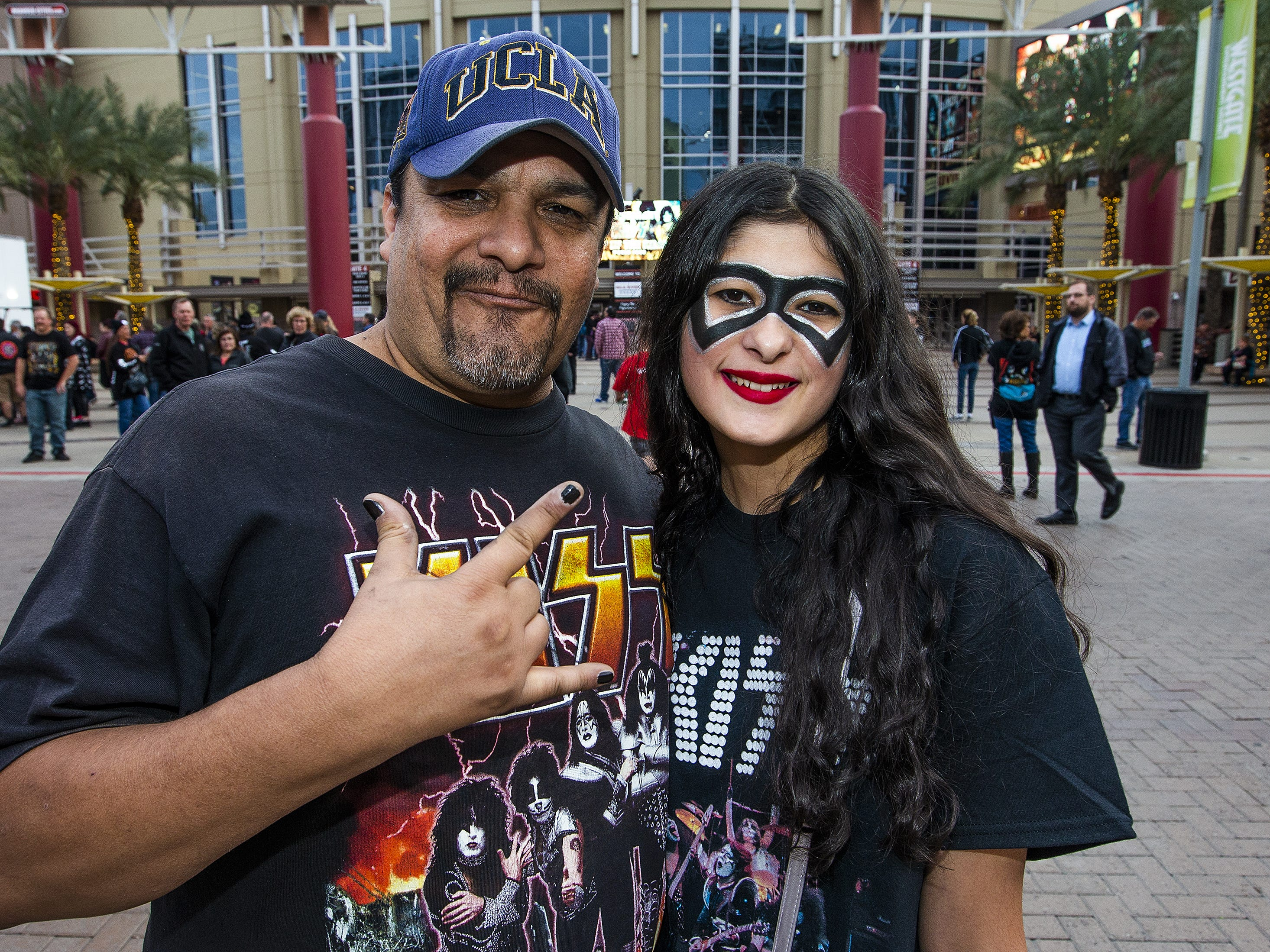 Dave Lopez, 52, and his daughter, Callie, 17, of Phoenix, show off their best Kiss makeup prior to the concert by the famed group at Gila River Arena in Glendale, Wednesday, Feb. 13, 2019.  The concert was part of the End of the Road World Tour, the band's farewell to the fans.