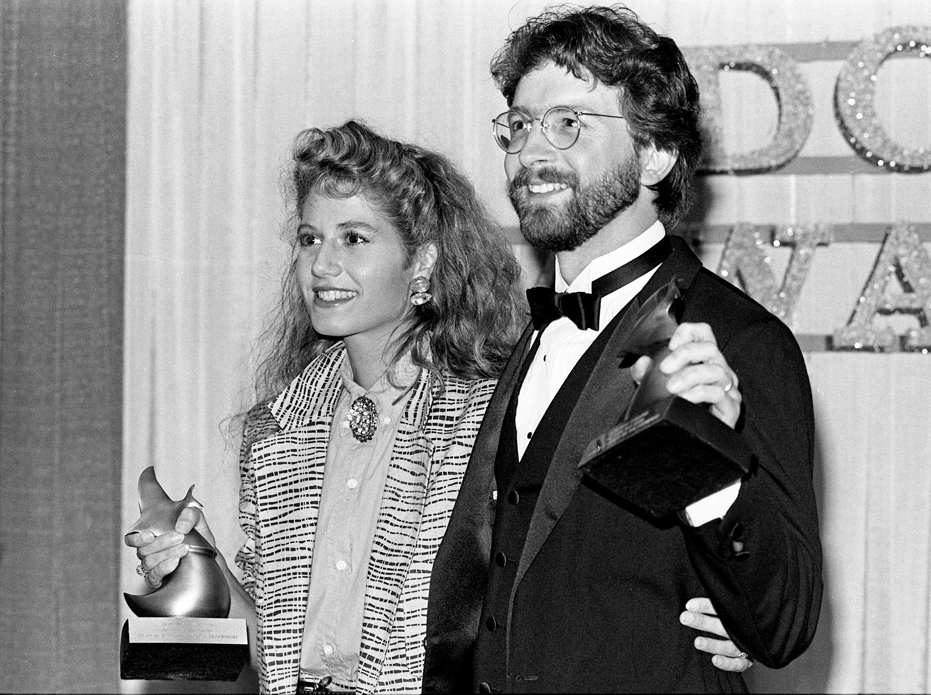 "Amy Grant and her producer, Brown Bannister, are seen backstage after winning the Contemporary Gospel Music Album of the Year for ""Straight Ahead"" during the annual Dove Awards show on April 3, 1985."