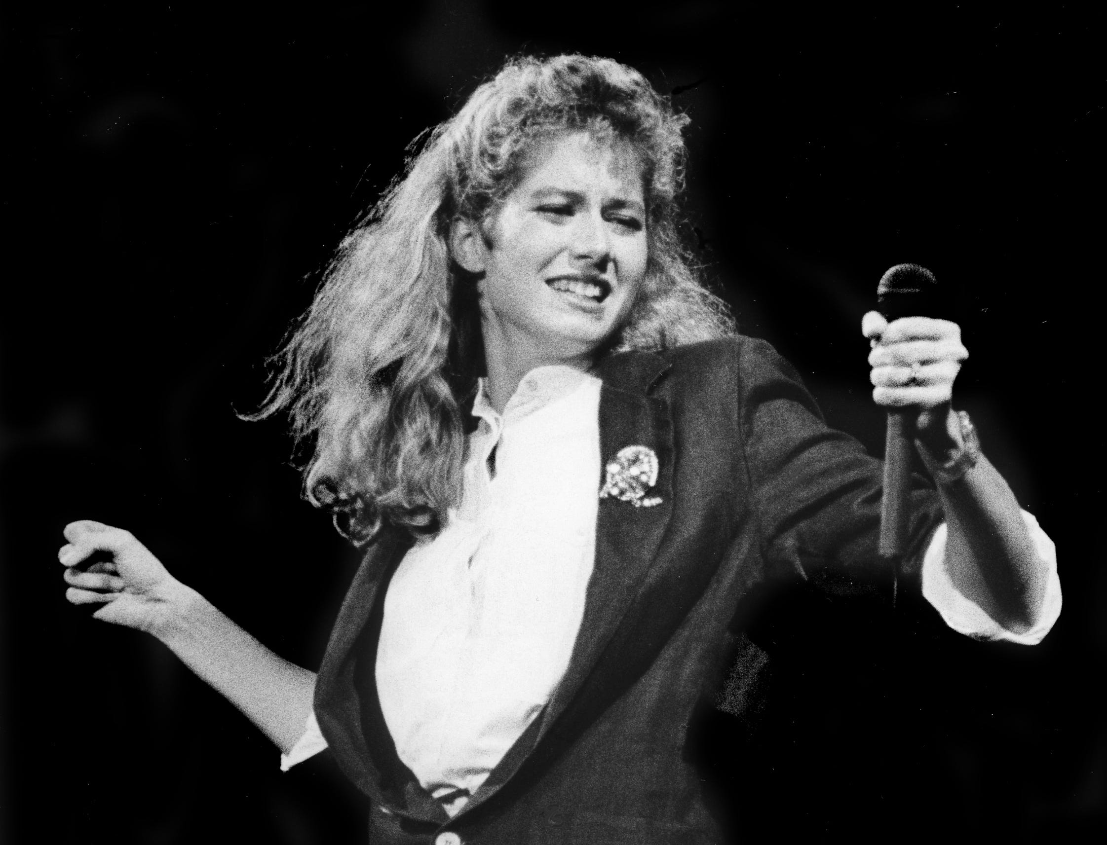 Contemporary Christian music diva Amy Grant celebrates before a capacity crowd at Middle Tennessee State University's Murphy Center on Oct. 20, 1985.