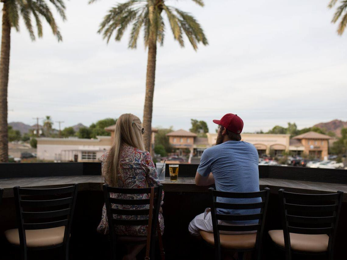 Attic Ale House has a bar with a view overlooking Camelback Mountains in Phoenix.